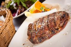 Stock Photo of Grilled beef steak with seasoning