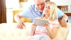 Mature couple using a digital tablet - stock footage