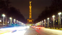 Time-lapse of Traffic pass by in front or the Victory Column in Berlin at night Stock Footage