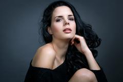 Dark moody portrait of a brunette beauty - stock photo