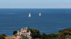 Couple Looking at Sailboats in the Distance Stock Footage