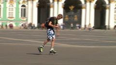 Man skates on roller-skaters on Palace Square. St. Petersburg. Russia. 2015 Stock Footage