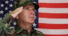Close Up Military Salute Woodland Camouflage Uniform United States Waving Flag Stock Footage