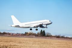 Passenger airliner taking off at an airport - stock photo