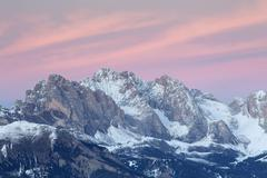 Sunset over the Geisler peaks in winter Saltria Province of South Tyrol Italy - stock photo