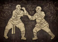 Monks practicing Kung Fu artwork on a wall near Shaolin Temple in Dengfeng Piirros