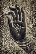 Stock Photo of Buddha hand Vitarka Mudra Buddhist gesture of discussion and debate