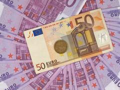 Greek monetary unit  drachma and Euro. Stock Photos