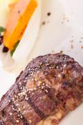 Grilled beef steak with seasoning - stock photo