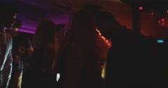 Silhouettes of party crowd in Night Club with disco lights Stock Footage