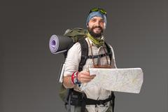 Portrait of a male fully equipped tourist - stock photo