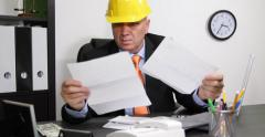 Nervous Engineer Looking Invoices Tax Refund Count Very Few Us Dollars Banknotes Stock Footage