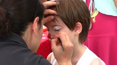 Face Painting of a Child, Carnival - stock footage