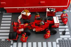 Pit stop of Ferrari F14 T race car by Lego Speed Champions - stock photo