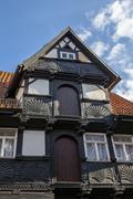 Ornately carved beams historic halftimbered house Quedlinburg Harz - stock photo