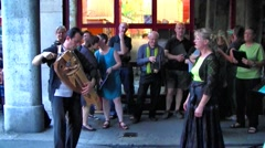 Man plays Hurdy Gurdy instrument, Chambery, France Carnival (with sound) Stock Footage