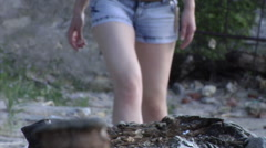 Feet girl walking on a log in sneakers Converse All Stars - stock footage