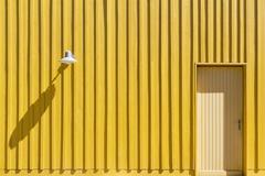 Facade of a yellow beach hut with door and lamp Ile dOleron Charente Maritime Stock Photos
