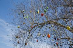 Handpainted ostrich eggs hanging on a tree Bad Schallerbach Austria Europe Stock Photos