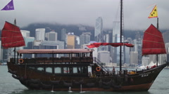 Side profile of elegant Chinese boat in HK 4K Stock Footage