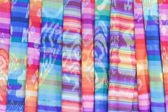 Colourful textiles on display for sale Ubud Bali Indonesia Asia Stock Photos