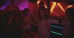 Singing and dancing the night away with friends Stock Footage