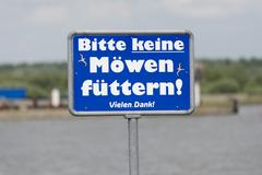 Sign Bitte keine Mowen futtern or Please do not feed the seagulls - stock photo