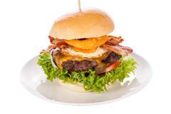 Delicious egg and bacon cheeseburger - stock photo