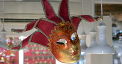 Red Venetian mask hanging in the store Stock Footage