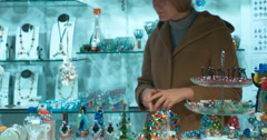 Woman Choosing a Gift in Murano Glass Shop in Venice Stock Footage