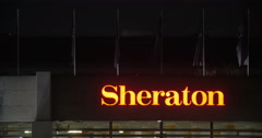 Night view of hotel Sheraton sign Stock Footage