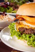 Delicious egg and bacon cheeseburger Stock Photos