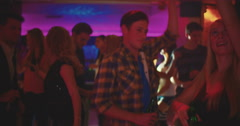 Guy enjoying the night club vibes in a relaxed style Stock Footage