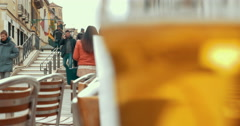 Glass with light beer in outdoor cafe Stock Footage