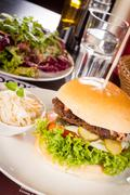 Cheeseburger with cole slaw - stock photo