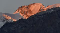 Paradiso group at sunrise alpenglow Gran Paradiso National Park Valle di Cogne Stock Photos