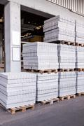Cement building blocks stacked on pallets - stock photo