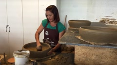"Woman making the famous Adobe Pan ""Panela de Barro"" - stock footage"