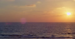 Beautiful Mediterranean sunset and  flying a triangular kite in the sky Stock Footage