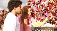 Couple looking at tree with love locks Stock Footage