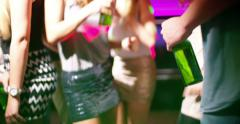 Dancing woman holding beer bottle in night club Stock Footage