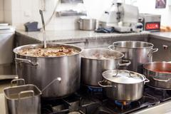 Cooking in a commercial kitchen Stock Photos