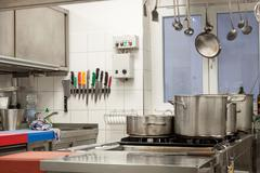 Neat interior of a commercial kitchen Stock Photos