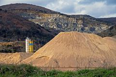 Pierced mountain quarry for stone quarrying and sand. Sand Mountain gravel pit - stock photo