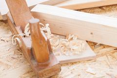 Handheld wood plane with wood shavings Stock Photos