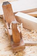 Stock Photo of Handheld wood plane with wood shavings