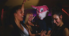 Guy with a bunny head with friends at party - stock footage