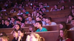 Students sit in big auditorium of Moscow State University. - stock footage