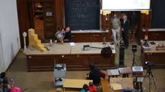 Physics experiment during lecture in auditorium in MSU Stock Footage