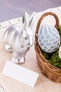 Easter still life with a silver bunny and eggs Stock Photos